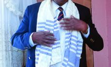 Edwin Mabudafhasi dons both kippa and tallit